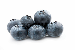 Fresh blueberries isolated against white background