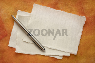 blank sheets of white Khadi rag paper