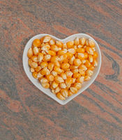 Corn kernels in a white bowl for food photography