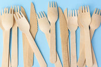 wooden forks and knives on a blue background