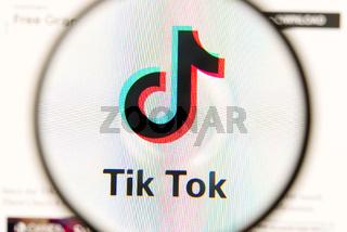 Estonia, Tallinn - August 30.08.2020: Tik Tok social media app icon under magnifying glass shoot from monitor. examining of Tik Tok logo under a magnifying glass, blured.