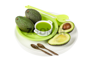 Fresh avocado with juice on the plate isolated