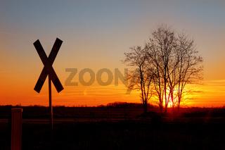Ein Andreaskreuz im Abendrot