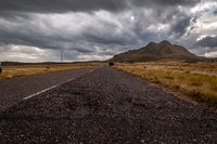The old Gold's Road at highest point in San Luis, Argentina, which climbs steppe mountains while a heavy storm is coming
