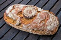 crispy walnut bread on a wooden table