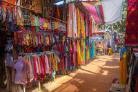 Indian bazaar benches with colorful saris