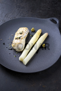 Fried Danish skrei cod fish filet with white asparagus