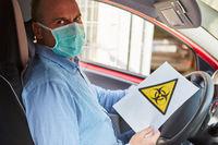Autofahrer mit Biogefährdung Warnung bei Covid-19