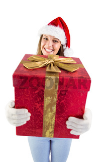Festive young woman holding a gift