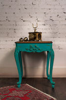 Green vintage wooden table and old golden telephone set
