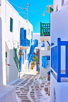 Old street with whitewashed houses in Mykonos