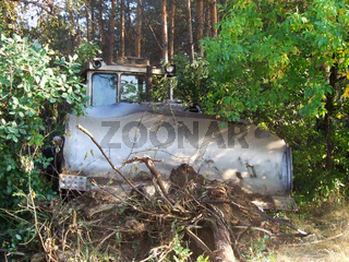 old bulldozer clears a path in the woods