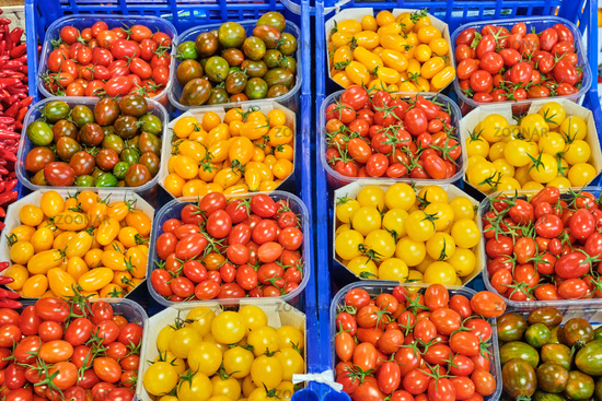 Cherry tomatoes in different colors for sale at a market