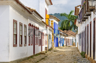 Cobblestone and old houses in colonial style on streets of old and historic city of Paraty