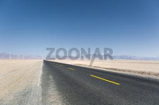 asphalt road through the wind farm