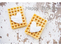 Very beautiful Belgian waffles on an old table-inscription of a happy birthday.