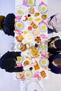 muslim family having a Ramadan feast top view