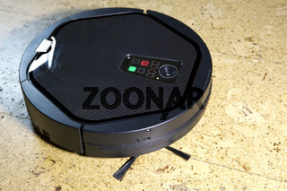 the robot the vacuum cleaner cleans a floor