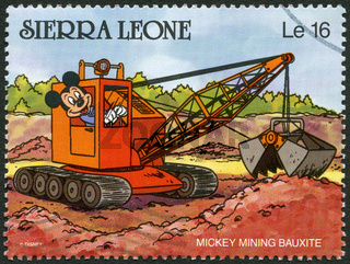 SIERRA LEONE - 1990: shows Mickey Mouse mining bauxite, Walt Disney Characters