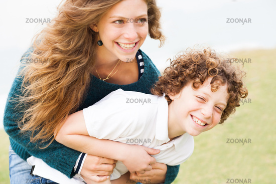 Happy mother and son playing