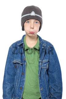 portrait of a sulking teenager boy with cap, isolated on white