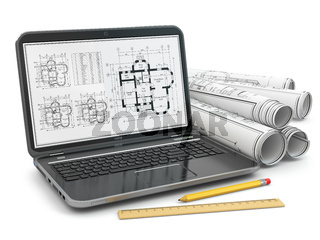 Laptop and blueprint with house project.