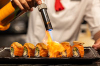Chef cooking Salmon Foie gras roll,