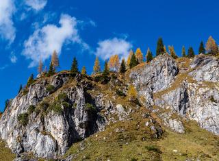 Autumn Alps rocky mountain tops view from hiking path, Kleinarl, Land Salzburg, Austria.