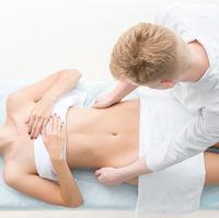 Massagyst massaging slim girl in saloon top view