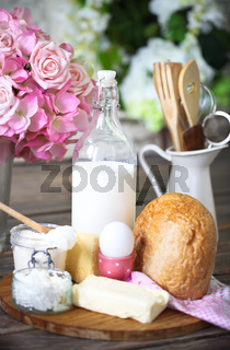 Ingredients for dough on white wooden table