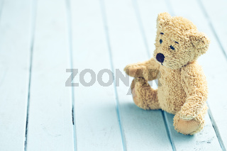 teddy bear on blue table