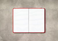 Red open lined notebook isolated on concrete background