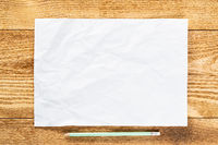 Sheet of paper lying on wooden table