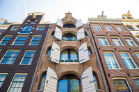 Facade of a traditional house in Amsterdam. Windows detail.