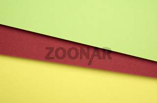 cardboard sheets of colored green, red and yellow paper