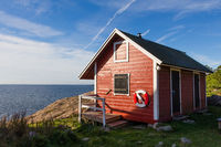 Red cottage at the coast Oxelosund in south Sweden