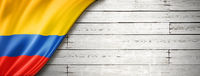 Colombian flag on old white wall banner