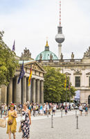 street scene in front of neue wache, new gardhouse, berlin cathedral and television tower in backgro
