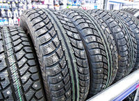 Winter vehicle tires stacked up for sale in the hypermarket