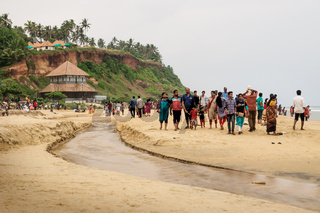 Local tourists at the temple at the beach of Varkala during sunset, India