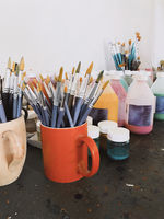 Creative workspace with painting tools on table