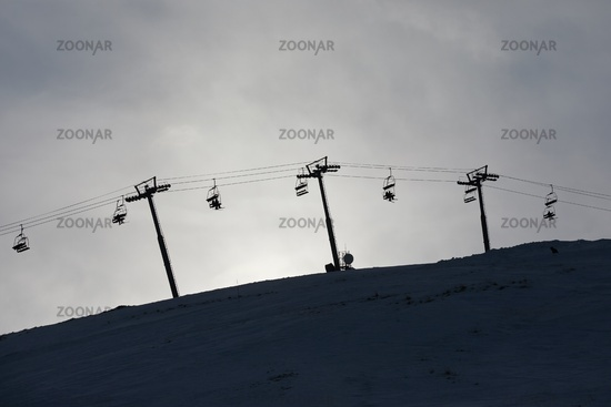 Ski lift cloudy sky silhouette
