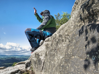 Man meditating in mountains. Travel Lifestyle