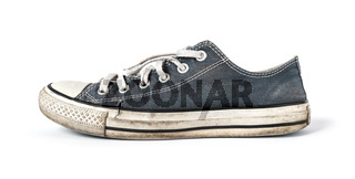 Old blue sneaker isolated on white background