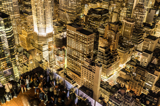 Rockefeller Center Observation Deck people 3 a view of the night view from the (top of the Rock)