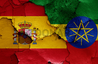 flags of Spain and Ethiopia painted on cracked wall