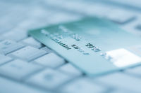 Bank creadit card on keyboard. Concept of online banking and internet purchase. Soft focus.