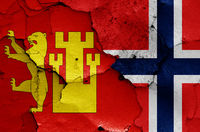 flags of Fredrikstad and Norway painted on cracked wall