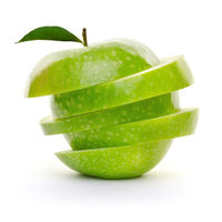 Green apple sliced in pieces isolated on white background