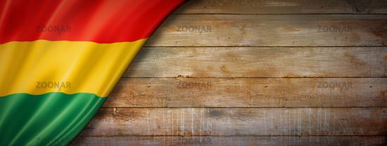 Bolivian flag on vintage wood wall banner